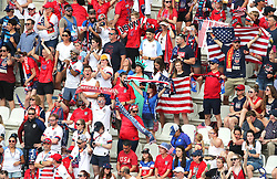 General view of the United States fans, including someone dressed as the Statue of Liberty before the game