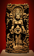 Siddha. Sandstone, Uttar Paradesh, 1000-1100. The goddess Siddha, a form of Gauri, holds lotus blossoms in her upper hands.  She is associated with the iguana, seen on the base below her feet.