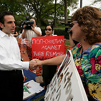 Bobby Schindler (L), greets supporters of his sister Terri Schiavo, outside the Woodside Hospice on March 24, 2005 in Pinellas Park, Florida. Schiavo still remains off a feeding tube despite the efforts of her parents REUTERS/Scott Audette