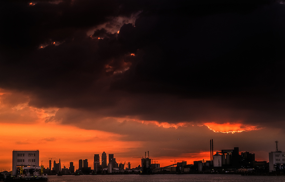 The sun sets over Canary Wharf in London. No sign of the four horsemen just yet...