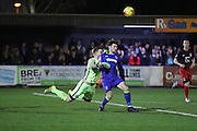 AFC Wimbledon midfielder Jake Reeves (8) and Coventry City goalkeeper Lee Burge (1) during the EFL Sky Bet League 1 match between AFC Wimbledon and Coventry City at the Cherry Red Records Stadium, Kingston, England on 14 February 2017. Photo by Stuart Butcher.