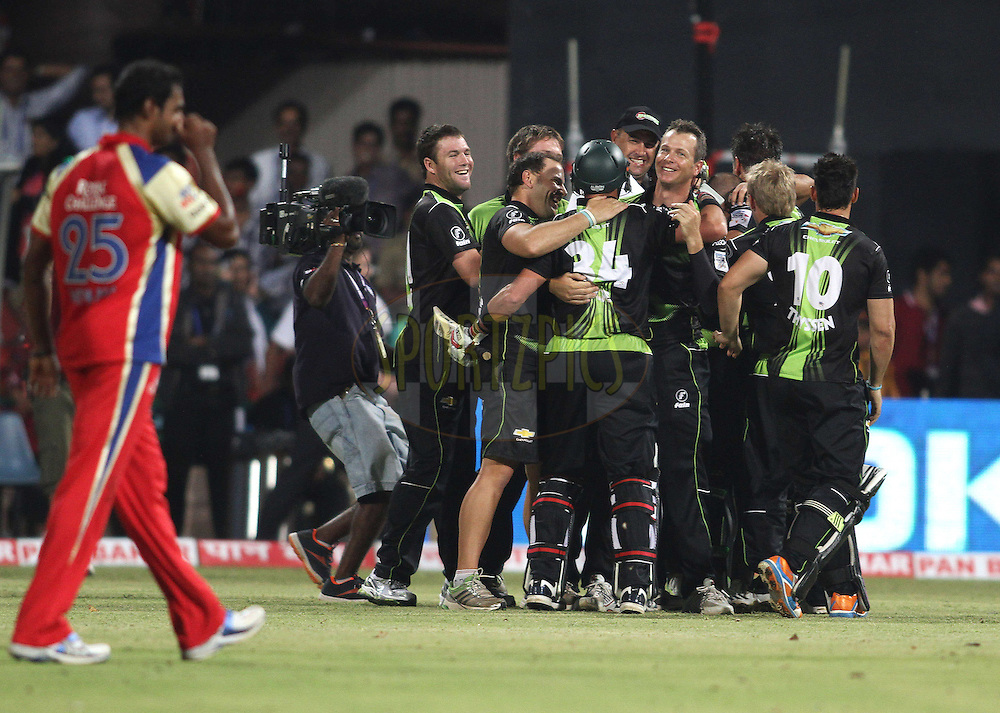 Warriors celebrate after beating Royal Challengers Bangalore during match 1 of the NOKIA Champions League T20 ( CLT20 )between the Royal Challengers Bangalore and the Warriors held at the  M.Chinnaswamy Stadium in Bangalore , Karnataka, India on the 23rd September 2011..Photo by Shaun Roy/BCCI/SPORTZPICS