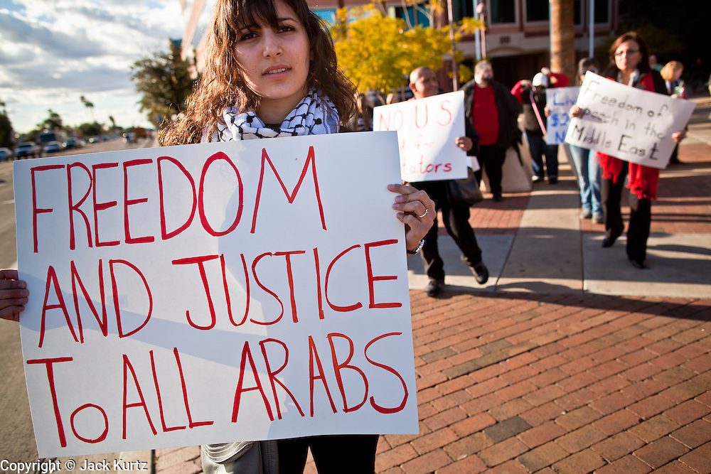 31 JANUARY 2011 - TEMPE, AZ: LINA BEARAT, an ASU student, at a demonstration in Tempe, AZ, supporting democracy in Egypt Monday. About 200 people marched through central Tempe, AZ, near the Arizona State University campus Monday afternoon. The rally was organized by the Arab American Association of Arizona in solidarity with the ongoing pro-democracy rallies and demonstrations in Egypt and other Arab countries.    Photo by Jack Kurtz