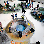 Visitors to the American Museum of Natural History in New York City explore an exhibit at the Hayden Planetarium, February 19, 2010.
