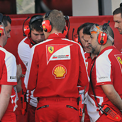 Meeting of minds with the Ferrari mechanics during the 2nd day of the F1 young driver/tyre test at the Silverstone Circuit, Northamptonshire on the 18th July 2013.<br /> WAYNE NEAL | SPORTPIX.ORG.UK