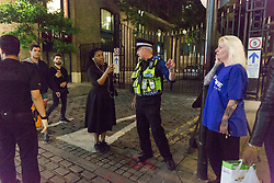 © Licensed to London News Pictures. 03/06/2017. LONDON, UK.  Police speak to concerned members of the public as they block the road and made a cordon in Tooley Street, to the south east of London Bridge.  A van and knife attack have been reported to have taken place on London Bridge this evening. Photo credit: Vickie Flores/LNP