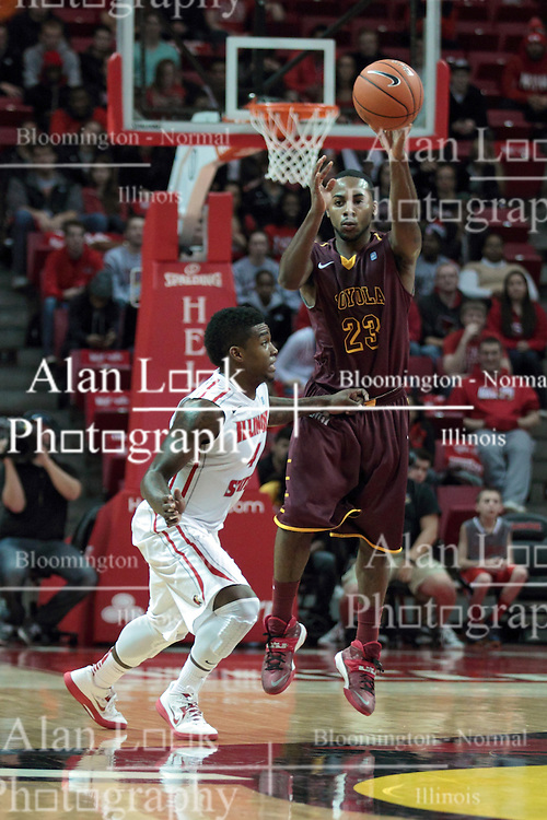 11 January 2014:  Bobby Hunter puts half court pressure on Jeff White to force a pass over the half way line during an NCAA  mens basketball game between the Ramblers of Loyola University and the Illinois State Redbirds  in Redbird Arena, Normal IL.  Redbirds win 59-50
