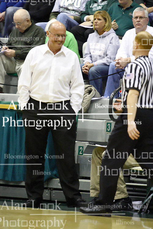 29 January 2011: Bosko Djurickovic makes light conversation with an official after a member of this team gets called for a foul during an NCAA basketball game between the Carthage Reds and the Illinois Wesleyan Titans at Shirk Center in Bloomington Illinois.