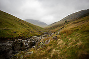 The valley with Ulls water river running through it looking up through the rain and clouds at Helvellyn, The Lakes District, United Kingdom. (photo by Andrew Aitchison / In pictures via Getty Images)