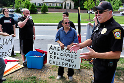 Members of the Industrial Workers of the World Lehigh Valley branch rally outside the KidsPeace Broadway campus in Sunday, July 27, 2014 in Fountain Hill, PA in support of the unaccompanied immigrant children who are temporarily housed there. (AP Photo/Chris Post)