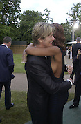 David Bowie and Iman. Serpentine Gallery Summer party in a glass and steel pavilion designed by Toyo Ito and Arup. . tuesday 9 July 2002. © Copyright Photograph by Dafydd Jones 66 Stockwell Park Rd. London SW9 0DA Tel 020 7733 0108 www.dafjones.com