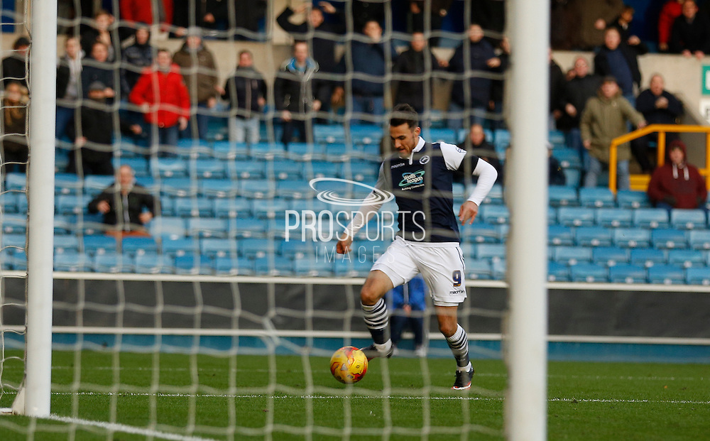 Millwall FC Forward Lee Gregory finds himself with an open goal but hits the post during the Sky Bet League 1 match between Millwall and Colchester United at The Den, London, England on 21 November 2015. Photo by Andy Walter.