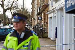 """© Licensed to London News Pictures.  13/02/2014. OXFORD, UK. A PCSO guards the scene after a suspect package was received at the Army recruitment office in St Giles, Oxford. The package was one of seven received across the country in the last two days and has been described as """"crude but potentially viable with hallmarks of Northern Ireland-related terrorism. Photo credit: Cliff Hide/LNP"""