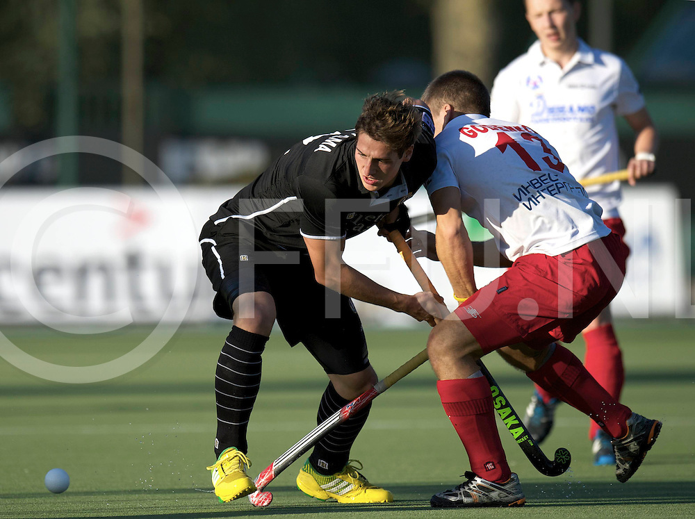 LILLE - Euro Hockey Leaque round 1.2<br /> 08 Racing Club de Bruxelles v Dinamo Elektrostal<br /> foto: Dalla Palma (black) and Godenkov (white).<br /> FFU PRESS AGENCY COPYRIGHT FRANK UIJLENBROEK