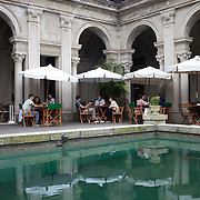 People enjoy Sunday brunch at the cafe inside the Parque Lage Mansion. Rio de Janeiro,  Brazil. 19th September 2010. Photo Tim Clayton.