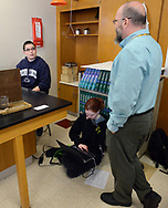 From left, Dakota Babalrabas, 15, poses a question to instructor Rich Staniec as Andrea Simon works on the floor during science class Friday, March 17, 2017 at Upper Perkiomen High School in Pennsburg, Pennsylvania. (WILLIAM THOMAS CAIN / For The Philadelphia Inquirer)
