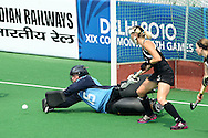 Beth Jurgeleit saves in her 100th match for the Blacksticks during the pool B women's hockey match of the The Commonwealth Games between New Zealand and Wales held at the Stadium in New Delhi, India on the  October 2010..Photo by:  Ron Gaunt/SPORTZPICS/PHOTOSPORT
