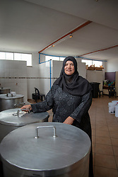 "Shanaaz Jacobs at the Masjidus Sabr mosque that has become headquarters for a joint, interfaith, Parkwood Covid-19 feeding response team. Volunteers today delivered bread to the community of Parkwood, a subburb of Cape Town, located on the Cape Flats, Monday, April 20, 2020. The majority of the people who live here are unemployed during ""normal"" circumstances. And as South Africa is now in lockdown due to the Coronavirus, many of those who had jobs have also lost their income. So many people are starving. The feeding scheme is a joint community effort, paid for solely by donations from the public to feed more than 3,000 households. The group is also receiving transportation support by The South African Red Cross Society. ""I do the cooking. On Wednesday, I will be making 10 x 100 litre pots of food,"" said Jacobs. ""Normally, I only supply 50 people with food, including kids, elderly, and the unemployed."" PHOTO: EVA-LOTTA JANSSON"