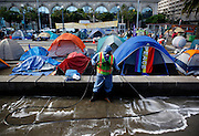 A worker with the city's Department of Public Works power washes a portion of the Occupy SF campsite in coordination with the campers on Thursday, Nov. 17, 2011, in San Francisco, Calif.  (AP Photo/Beck Diefenbach)