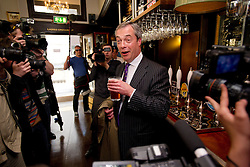 © London News Pictures. 03/05/2013. London, UK. UKIP part leader NIGEL FARAGE drinking a pint of beer at the The Marquis of Granby pub in Westminster London in front of  media  following his party's success in the council elections across England. Photo credit: Ben Cawthra/LNP.