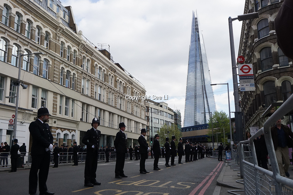 London,England,UK.9th April 2017. Stand for Keith cortege procession for funeral of PC Keith Palmer at Southwark street,London,UK. by See Li