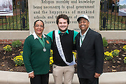 Ohio University President, Roderick McDavis, and Ohio University First Lady, Deborah McDavis, pose with Zak Roe, a member of Ohio University's Homecoming Court, at the College Gateway on October 8, 2016.