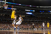 Glenn Robinson III (1) of the University of Michigan Wolverines dunks the ball against the University of Kansas Jayhawks during the NCAA South Regionals at Cowboys Stadium in Arlington on Friday, March 29, 2013. (Cooper Neill/The Dallas Morning News)
