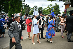 © Licensed to London News Pictures. 19/06/2018. London, UK. Race goers arrive at Day one of Royal Ascot at Ascot racecourse in Berkshire, on June 19, 2018. The 5 day showcase event, which is one of the highlights of the racing calendar, has been held at the famous Berkshire course since 1711 and tradition is a hallmark of the meeting. Top hats and tails remain compulsory in parts of the course. Photo credit: Ben Cawthra/LNP