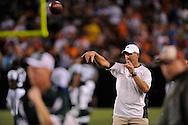 New York Jets quarterback Brett Favre throws a football during a lightning delay August 7, 2008 at Cleveland Browns Stadium.