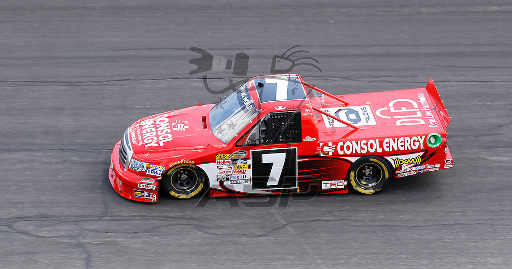 ROCKINGHAM, NC - APR 13, 2012:  John King brings his truck through the turns during a practice session for the Inaugural Good Sam Roadside Assistance 200 at the Rockingham Speedway in Rockingham, NC.
