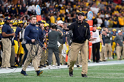 Michigan Wolverines head coach Jim Harbaugh reacts to a play during the Chick-fil-A Peach Bowl, Saturday, December 29, 2018, in Atlanta. ( Paul Abell via Abell Images for Chick-fil-A Peach Bowl)