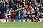 Brentford midfielder Alan Judge celebrates his stunning strike only minutes in the first half during the Sky Bet Championship match between Brentford and Rotherham United at Griffin Park, London, England on 17 October 2015. Photo by Andy Walter.