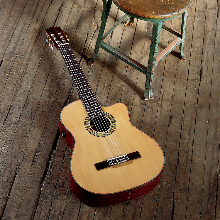 Ibanez Acoustic guitar laying on wooden floor next to an old metal stool with a wooden seat. One of a set of images I shot for an Ibanez Acoustic Guitars catalog. These images were shot in a textile mill in Bristol, Pennsylavania dating back to the 1700s.