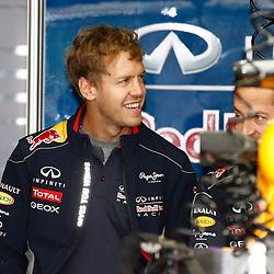 FORMULA 1 SANTANDER BRITISH GRAND PRIX ..Sebastian Vettel chats with his engineers in the Red Bull garage....(c) STEPHEN LAWSON | SportPix.org.uk