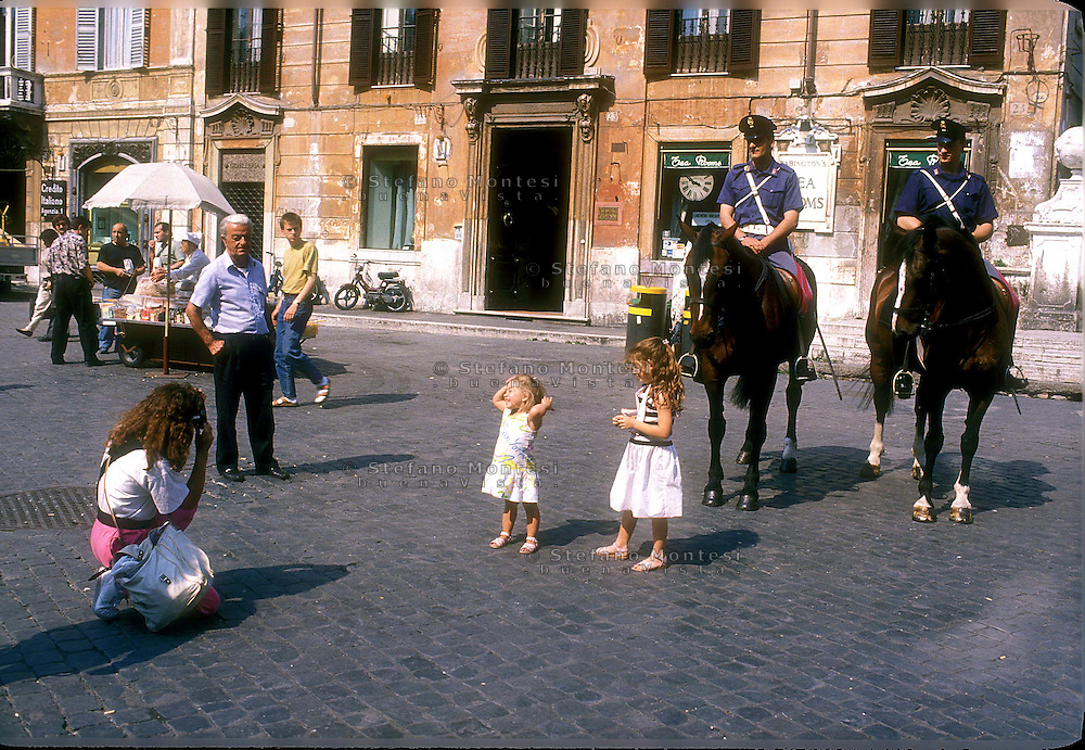 Rome  June 2004..Mounted police units  in Piazza di Spagna..Photo Memory Of Two Children with Mounted police units
