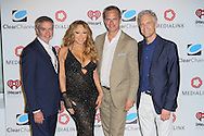 CAP D'ANTIBES, FRANCE - JUNE 17:  Bob Pittman – Clear Channel CEO, Mariah Carey, Tom Poleman – President of Programming, Clear Channel and John Sykes – President of Entertainment Enterprises, Clear Channel attend Clear Channel Media And Entertainment And MediaLink Dinner at Hotel du Cap-Eden-Roc on June 17, 2014 in Cap d'Antibes, France.  (Photo by Tony Barson/Getty Images for Clear Channel)