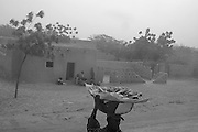 meat seller during Harmattam wind
