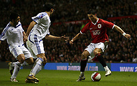Photo: Paul Thomas.<br /> Manchester United v Europe XI. Friendly match. 13/03/2007.<br /> <br /> Cristiano Ronaldo (R) of Utd pulls out the tricks in front of Gianluca Zambrotta (C) Gennaro Guttuso (L).
