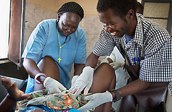 Nurse Rebecca Akuat and Dr. Richard H. Kinarro help 18-year-old Ding Makur through labor at the Juba Teaching Hospital in South Sudan.