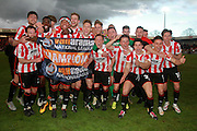 The Cheltenham team celebrate the championship after the Vanarama National League match between Cheltenham Town and Lincoln City at Whaddon Road, Cheltenham, England on 30 April 2016. Photo by Antony Thompson.