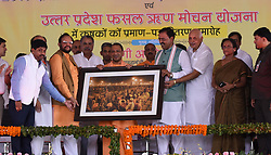September 6, 2017 - Allahabad, Uttar Pradesh, India - Allahabad: BJP leader offer a photo of Kumbh area to Uttar Pradesh Chief minister Aditya Nath during a programme at Parade ground in Allahabad on 06-09-2017. Photo by prabhat kumar verma (Credit Image: © Prabhat Kumar Verma via ZUMA Wire)