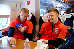 RUNCORN, ENGLAND - Tuesday, May 22, 2018: Wales' goalkeeper Adam Davies and Lee Evans travel by train as the squad heads to Heathrow for a flight to Los Angeles ahead of the international friendly match against Mexico. (Pic by David Rawcliffe/Propaganda)
