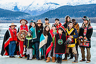 Klukwan native tribe in ceremonial clothing celebrating at the eagle festival at the Chilkat Bald Eagle Preserve near Haines in Southeast Alaska. Winter. Afternoon.