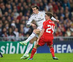 MADRID, SPAIN - Tuesday, November 4, 2014: Real Madrid's Gareth Bale and his Wales team-mate Liverpool's Joe Allen during the UEFA Champions League Group B match at the Estadio Santiago Bernabeu. (Pic by David Rawcliffe/Propaganda)