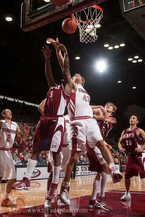 November 25, 2006; Stanford, CA, USA; Stanford Cardinal center Robin Lopez (42) fights for the rebound against Denver Pioneers forward Joseph Jackson (15) during the game at Maples Pavilion. The Cardinal defeated the Pioneers 82-39.