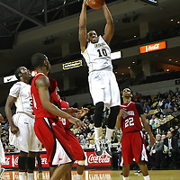 Central Florida forward Dwight McCombs (10) slams the basketball against Louisville during their game at the UCF Arena on December 15, 2010 in Orlando, Florida. UCF won the game79-58. (AP Photo/Alex Menendez)