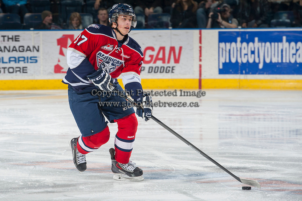 KELOWNA, CANADA - MARCH 8: Parker Wotherspoon #37 of the Tri-City Americans skates with the puck against the Kelowna Rockets on March 8, 2014 at Prospera Place in Kelowna, British Columbia, Canada.   (Photo by Marissa Baecker/Getty Images)  *** Local Caption *** Parker Wotherspoon;