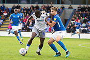 Colchester United forward Frank Nouble tackled by  Macclesfield Town defender Theo Vassell during the EFL Sky Bet League 2 match between Macclesfield Town and Colchester United at Moss Rose, Macclesfield, United Kingdom on 28 September 2019.