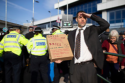 © Licensed to London News Pictures. 10/10/2019. London, UK. An Extinction Rebellion activist protests outside London City airport on the fourth day of direct action . Photo credit: George Cracknell Wright/LNP