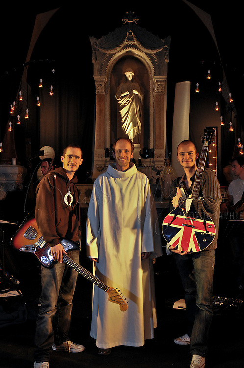 LYON, FRANCE - January 01: The &quot; gospel rock&quot; is coming in France. January 01,2011<br /> <br /> Transforming a chapel as a concert hall and renew the church, is the challenge created by the meeting of Benjamin and Thomas POUZIN with Father David GREA newly appointed to Lyon.<br /> Supported by Philippe Barbarin, Cardinal Primate of the Gauls and Lyon, they have been to Rome to offer two of their albums to the Pope.<br /> <br /> One of their aims: decomplex faith.<br /> <br /> Largely inspired by Hill Song Church in Sydney, which attracts 22,000 people, their lyrics speak of God and they go straight to the point.<br /> <br /> Originally founded in 2001 with their brother Aurelian, this band was a flying start with over 35,000 sales on their first album.<br /> &quot;Christian music is a very small community in France,&quot; said Benjamin POUZIN. Ordinarily, 3000 sales, is a success, while all records sold in France, all styles, is hardly what sells in the U.S. in Christian music, 20% of their market. &quot;<br /> <br /> &quot;The aim is that people sing with us. We make a pop-rock music, a little bit like Coldplay, but our texts refer to God, &quot;<br /> &quot;Our success is proof that we need to renew some way to proclaim the faith.<br /> And it was something very expected by the Christians.<br /> Our audience has so many fervent Christians that people who practice just a little bit the religion. &quot;<br /> <br /> &quot;We are the first group of Pop Praise Made in World Youth Day,&quot; said Benjamin. During the WYD, we found lot of evangelical groups, for most Protestants, this movement being the most important for this style of music.<br /> This music has existed since the 60s in the U.S. but now it only happens here. We are the pioneers in Catholic circles to have &quot;released&quot; our electric guitars. At that time, in France,  it was without precedent.&quot;<br /> With four albums they have made over 100,000 sales and regularly give free concerts in Lyon Center, Rue de Conde.<br /> Their dream: rent the Halle Tony Garnier every week and fill it with free concerts.